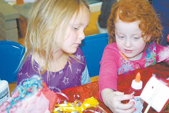 By Sandi HooverBella Leverenz, 5, right, selects a bottle of glitter glue to decorate her dragon, as her friend, Shannon Sturgis, 6, looks on at the Children's Museum of Northern Nevada.