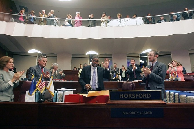 Senate Majority Leader Steven Horsford, D-Las Vegas, center, waves after receiving a gift from Sen. Terry Care, D-Las Vegas, in the Senate Chambers at the Nevada Legislature around 8:50 p.m., in Carson City, Nev.