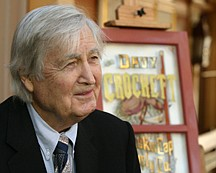"""In this Dec. 15, 2004 photo released by Disney, actor Fess Parker is shown at Disneyland on the 50th anniversary of his debut as TV's """"Davy Crockett,"""" when the park unveiled a tribute window honoring Parker in Anaheim, Calif. Family spokeswoman Sao Anash says Parker died Thursday, March 18, 2010, of natural causes at his Santa Ynez home near the Fess Parker Winery. He was 85. (AP Photo/Disneyland, Paul Hiffmeyer)"""