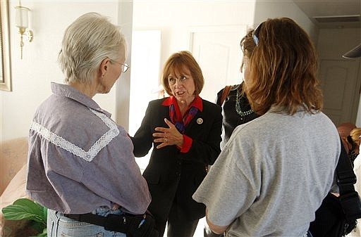 """FILE - In this May 18, 2010, file photo Sharron Angle, center, a Republican Senate candidate endorsed by the Tea Party Express, holds a meet and greet at a home in Pahrump, Nev.  """"A tsunami of conservatism is coming in waves across our country,"""" says Angle, who is running for the nomination to oppose Senate Majority Leader Harry Reid. """"My message is, this is what people want."""" Tea party activists figure in an unpredictable race in Nevada, where unemployment is 13.7 percent, and Reid has poll numbers as weak as any incumbent in the country.  (AP Photo/Isaac Brekken, File)"""