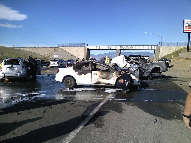 Fran Norton/Nevada AppealTwo people died in a fiery three-car crash Tuesday morning.