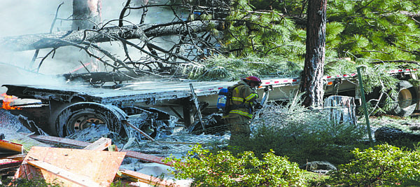 Jason Shueh/Nevada Appeal News ServiceA slurry of fire-suppressing foam covers the remains of the big rig that flew off the runaway ramp on Friday morning near the intersection of state routes 431 and 28 in Incline Village and crashed into a two-story house on Second Creek Drive.