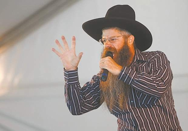 Cowboy poet Tony Argento performs on the main stage in Mormon Station State Historic Park in Genoa during a previous Genoa Cowboy Poetry & Music Festival.