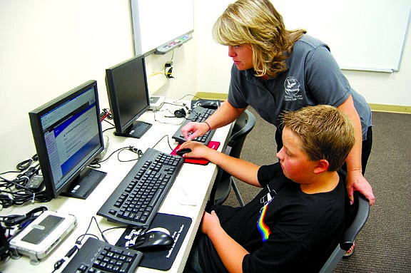 Brian Duggan/Nevada AppealVice Principal Cindy Talia helps seventh grader Jakob Wingfield on his first day at Silver State Charter Middle School on Monday.
