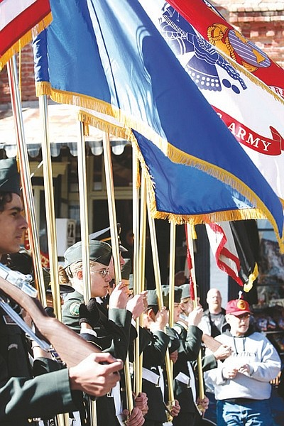 Shannon Litz/Nevada AppealThe Incline High School JROTC Color Guard marches in the Virginia City Veterans Day Parade on Thursday.