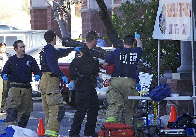 Emergency personnel set up outside the  shopping center in Tucson, Ariz. on Saturday, Jan. 8, 2011 where U.S. Rep. Gabrielle Giffords, D-Ariz., and others were shot as the congresswoman was meeting with constituents.  (AP Photo/James Palka)