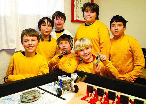 Shannon Litz/Nevada AppealAdam Daniels, 10, Enrique Sanchez, 13, Ryan Lucky, 13, Matthew Gunkel, 10, Kaleb VanMeter, 13, Tristan Bailey, 10, and Zach Frewert, 11, with their robot.