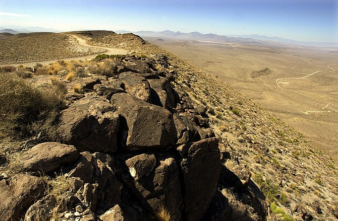 ** FILE ** In this June 25, 2002 file photo, the view from the summit ridge of the proposed Yucca Mountain nuclear waste dump near Mercury, Nev.,looking west towards California.  For two decades, a ridge of volcanic rock 90 miles northwest of Las Vegas known as Yucca Mountain has been the sole focus of government plans to store highly radioactive nuclear waste.  Thursday, Energy Secretary Steven Chu told a Senate hearing that the Yucca Mountain site no longer was viewed as an option for storing reactor waste, brushing aside criticism from several Republican lawmakers.  (AP Photo/Joe Cavaretta, File)
