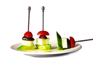 Scott Phillips/'Fine Cooking Appetizers&#821Greek salad on a stick makes a light and attractive appetizer.