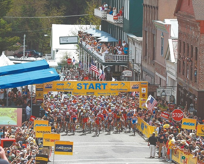 Riders take off at the start of the first stage of the Tour Of California cycling race in Nevada City, Calif., Sunday, May 16, 2010. (AP Photo/Marcio Jose Sanchez)