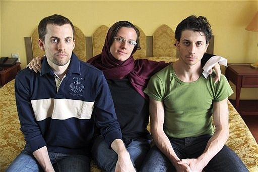 FILE - In this May 20, 2010 file photo, American hikers Shane Bauer, left, Sarah Shourd, center, and Josh Fattal, sit at the Esteghlal Hotel in Tehran, Iran. An Iranian court is holding a closed-door session Sunday Feb. 6, 2011 to begin proceedings against three Americans detained 18 months ago and accused of spying. It was unclear whether the two men were present Sunday in the Tehran Revolutionary Court, which deals with security-related charges. Authorities imposed a blanket ban for observers, including Swiss Ambassador Livia Leu Agosti who represents U.S. interests in Iran. (AP Photo/Press TV, File)