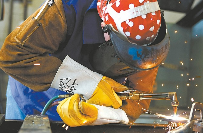 Photos by  Shannon Litz Nevada AppealCarson High School junior Jake Williamson, left, competes Saturday in oxy-acetylene cutting with a torch at Western Nevada College.