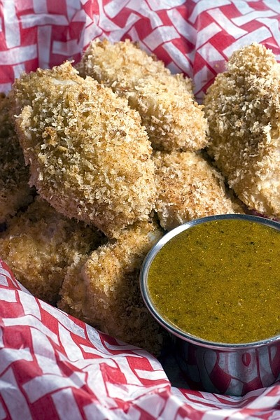 This Dec. 5, 2010 photo shows crunchy fish nuggets with curried-mustard dipping sauce in Concord, N.H. To keep the joy but battle the bulge, consider healthy homemade fast food this holiday season.   (AP Photo/Larry Crowe)
