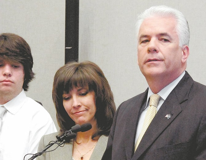 U.S. Sen John Ensign, R-Nev., accompanied by his wife Darlene and son Trevor, announces he will not be a candidate for re-election, during a news conference in Las Vegas on Monday, March 7, 2011. (AP Photo/Oskar Garcia)