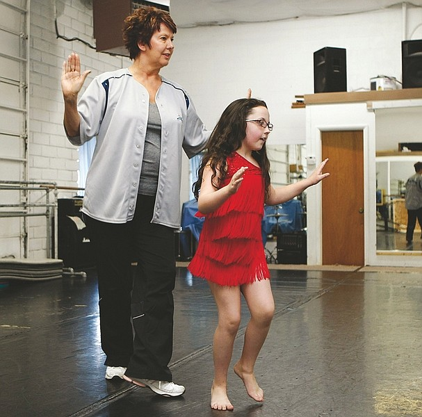 Shannon Litz/Nevada AppealGina Kaskie-Davis of Western Nevada Performing Arts watches 9-year-old Makayla Schmidt dance in her costume on Friday at the studio.