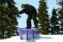 Published Caption: Pat Quinn, a Ralston team member, boardslides a down rail in the Alley at Sierra At Tahoe.