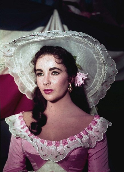 """FILE - In this 1957 file photo, actress Elizabeth Taylor is shown in costume for her character in the film """"Raintree County."""" Publicist Sally Morrison says the actress died Wednesday, March 23, 2011 in Los Angeles of congestive heart failure at age 79. (AP Photo/File)"""