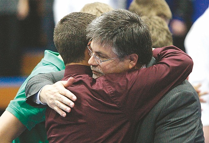 Shannon Litz / Nevada AppealStephen Anderson's father, Chris, hugs Skyler Guimont during the memorial service for Stephen Anderson and Keegan Aiazzi at Carson High School on Saturday.