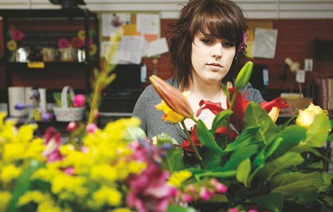 Shannon Litz/Nevada AppealMeaghan Schmidt works on an arrangement at Alie's Flowers and Gifts in Carson City on Wednesday afternoon.