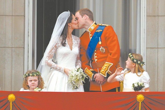 Britain's Prince William kisses his wife Kate, Duchess of Cambridge on the balcony of Buckingham Palace after the Royal Wedding in London Friday, April, 29, 2011. (AP Photo/Matt Dunham)