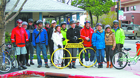 Courtesy Ashley DaleSteve Lasco, fourth from right in the red, joined with community leaders and members of Musclepowered to promote National Bike Month.
