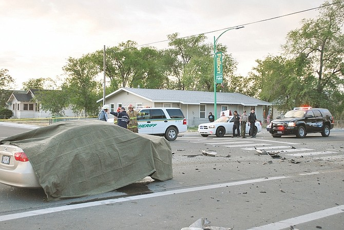 Steve Ranson/Lahontan Valley NewsPolice officials at the scene of an accident that left two people dead early Thursday.