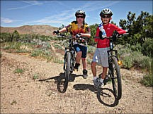 Courtesy Jeff MosrLocal cycling advocate Jeff Moser took his son, left, and friend out for a mountain bike ride this week.