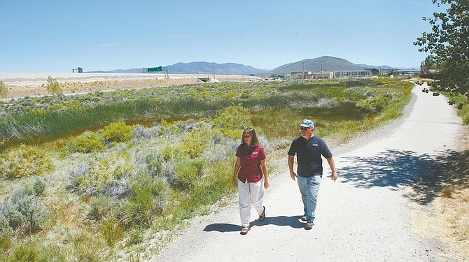 Jim Grant/Nevada AppealAnn Bollinger, left, Carson City natural resource specialist for the Open Space Division, and Vern Krahn, Carson City's park planner walk the new trail at the Fulstone Wetlands open space park.