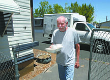 Jim Grant/Nevada AppealMike Stabenchek of Meals on Wheels delivers a meal to a Carson City resident on Tuesday afternoon.