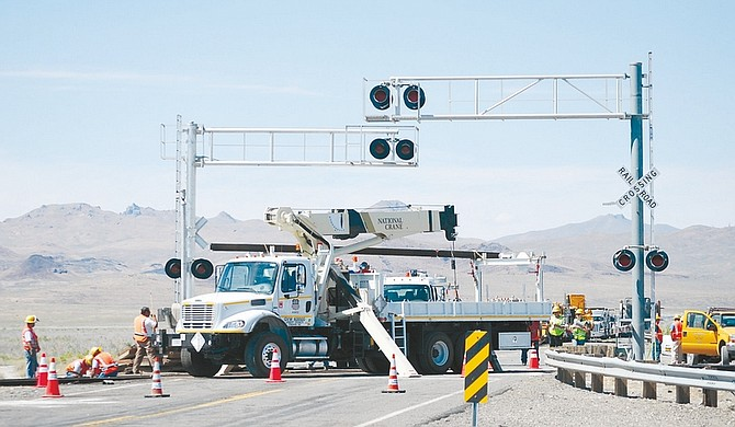 Steve Ranson/Lahontan Valley NewsUnion Pacific crews began working on the railroad crossing south of the Trinity exit Saturday to repair the track and signal devices. A semitruck smashed into an Amtrak passenger train Friday, killing at least six people, including the truck's driver, and injuring scores more.