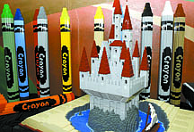 "Shannon Litz/Nevada Appeal'Pop-Up Book' which used 10,820 Lego bricks and 'Crayons' which are each 37"" x 4"" x 4"" are on display at the children's museum on Friday."