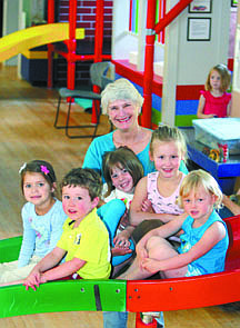 Jim Grant/Nevada AppealChildren's Museum volunteer Penny Holbrook enjoys playtime with, from left, Ava Ziegler, 4, Parker Hale, 3, Jayden Gongaware, 5, Emma Deusenberry, 6 and Ainsley Dally, 4.