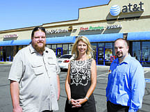 Shannon Litz/Nevada AppealCarson City Locksmith owner J.J. Heyer, Property Manager of Capital City Center Vicki Hone and AT&T Store Manager Steve Buffo are seen in front of the remodeled Capital City Center on Thursday morning.