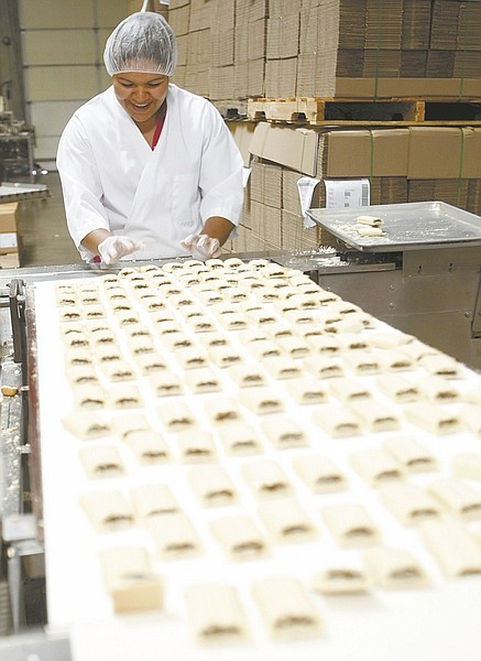 Shannon Litz/Nevada AppealYolanda Pacheco works on the assembly line at Nature's Bakery making fig bars.