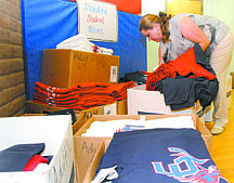 Shannon Litz/Nevada AppealMaria Cortez, the vice principal's secretary at Eagle Valley Middle School, fills a school uniform order on Thursday evening during the back to school boot camp.