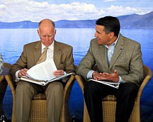 California Gov. Jerry Brown, left, and Nevada Gov. Brian Sandoval attend the 15th annual Tahoe Summit on Tuesday, Aug. 16, 2011 at Homewood Mountain Resort in Homewood, Calif.  Brown and Sandoval are pledging to work together to protect Lake Tahoe even as tensions between the neighboring states and a regulatory agency simmer. The two governors vowed Tuesday at the 15th Annual Lake Tahoe Summit that they would cooperate to update the lake's 20-year regional plan, which guides development and environmental regulations in the region. (AP Photo/Sandra Chereb)