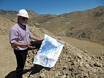 In this July 25, 2011 photo, Doug McQuide, of Comstock Mining Inc., explains the company's plans for open pit mining near Gold Hill, Nev.  Residents in Nevada's historic Comstock region fear open pit operations will ruin the ambience of their Old West communities and ruin their tourism economy. (AP Photo/Sandra Chereb)