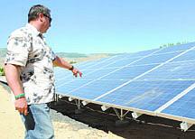 Shannon Litz/Nevada AppealMark Korinek talks abut the broken solar panels at Seeliger Elementary School on Friday.