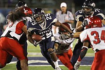 Nevada Reno's Mark Lampford rushes for 13-yards in the fourth quarter against Eastern Washington in an NCAA college football game in Reno, Nev., on Thursday, Sept. 2, 2010. (AP Photo/Cathleen Allison)