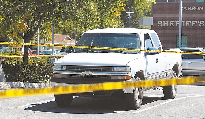 Shannon Litz/Nevada Appeal A truck driven by a man who reported a shooting Saturday is parked near the Carson City Sheriff's Office.