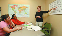Jim GrantTutor Carolyn Kellogg works with Loyda Herrera and Josefina Rodriguez on their English skills.