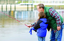 Nevada Appeal File PhotoCraig Wooding helps his granddaughter, Dalace Temple, at the Carson Fishing Pond last year.