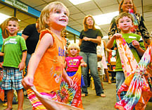 Shannon Litz/Nevada AppealThree-year-old Victoria Williams dances with scarves at the Carson City Library on Thursday morning during the Music Together program.