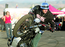 Nevada Appeal File PhotoStunt rider Jason Pullen performs at Carson City Harley-Davidson last year during their Street Vibrations celebration. Pullen will be performing again this year on Friday and Saturday at dealership on Research Way.