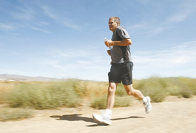 Photos by Shannon Litz / Nevada AppealCalvin Dutton trains for his run at the Rolling A Recreational Open Space on Saturday.