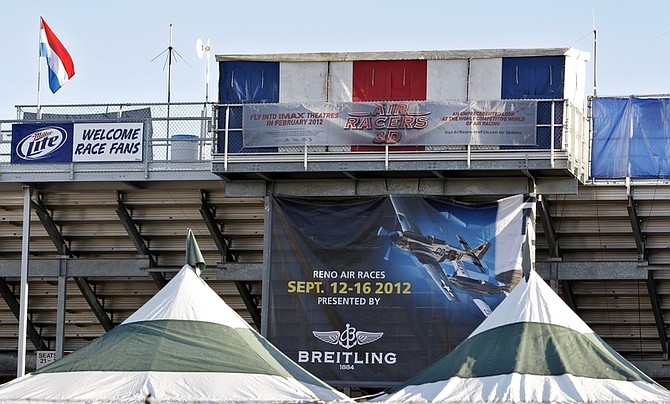 CORRECTS TO INJURED, NOT INURED - A banner announcing the Reno Air Races hangs at the back of the grandstands at an airport in Reno, Nev., Monday, Sept. 19, 2011, where the Reno Air Races were held. The Reno Air Races were canceled after pilot Jimmy Leeward's plane crashed on Friday. Several people were killed, including Leeward, and dozens more were injured. (AP Photo/Paul Sakuma)