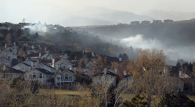 A 2,000-acre brush fire burns in south Reno, Nev., on Friday, Nov. 18, 2011. More than 25 homes have been lost and while contained, the fire continues to burn in high winds with gusts up to 60 mph. (AP Photo/Cathleen Allison)