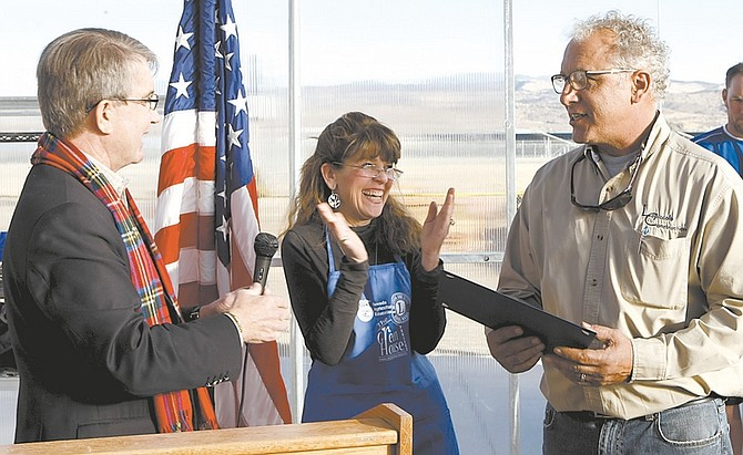 Shannon Litz/Nevada AppealCarson City Mayor Bob Crowell and Greenhouse Project President Karen Abowd present Mark Lopiccolo with a commendation at The Greenhouse Project ribbon cutting on Friday afternoon.
