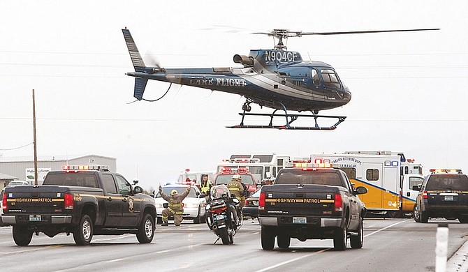 Published Caption: CareFlight takes off from the scene of a fatal accident in Mound House on Friday afternoon.