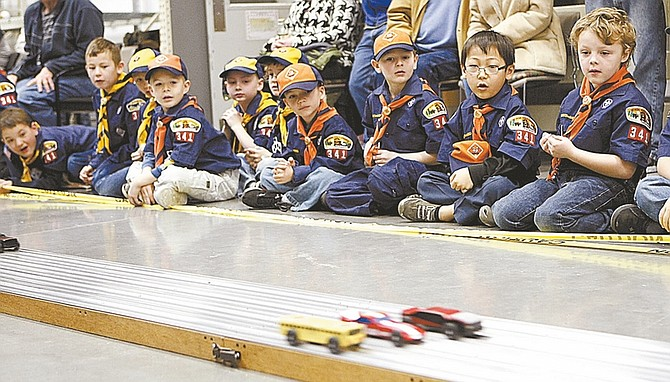 Shannon Litz/Nevada AppealPinewood Derby participants from Boy Scout Pack 341 watch a race during the annual Carson City event at The Home Depot on Saturday morning.